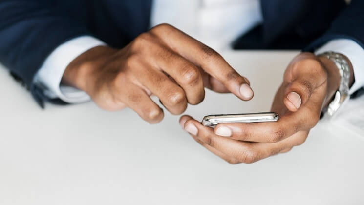 business hands touch the smartphone