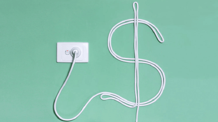 Energy wire trailing from socket arranged into dollar sign
