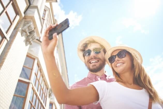 smiling-couple-taking-a-selfie